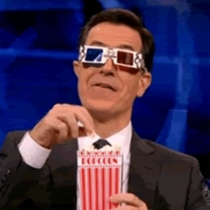 http://mrwgifs.com/wp-content/uploads/2013/03/Stephen-Colbert-Is-Ready-For-The-Show-With-Popcorn-3D-Glasses-Gif_408x408.jpg