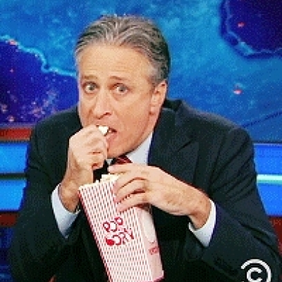 Jon-Stewart-Eagerly-Watching-Eating-His-
