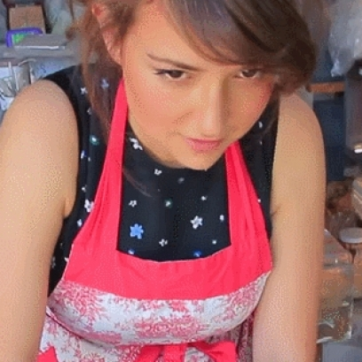 Milana Vayntrub Winks For The Camera As She Cooks ATT Mobile Girl_408x408 terrible charmander totatto meme gets animated, the flame makes it okay
